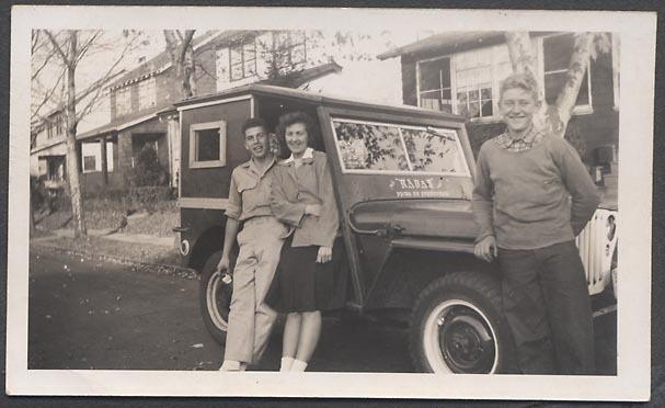 3-people-vintage-jeep-wood-hardtop
