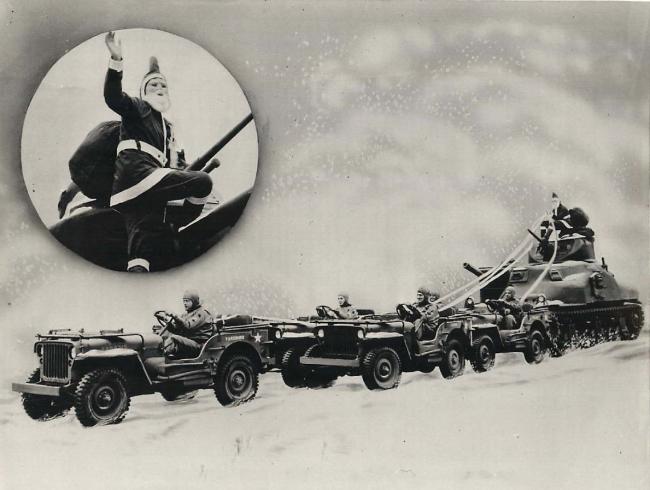 1942-12-20-santa-claus-jeeps-pull-tank1