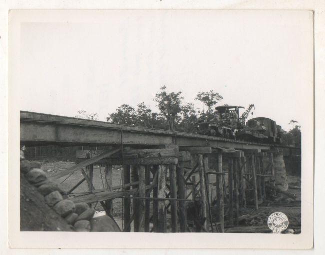 1944-12-21-jeep-train-burma-bridge1