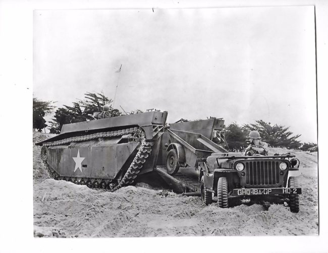 1945-11-jeep-exiting-water-buffalo-tractor1