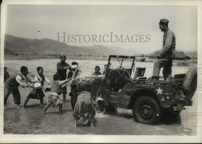 1951-05-01-korea-kids-washing-jeep1