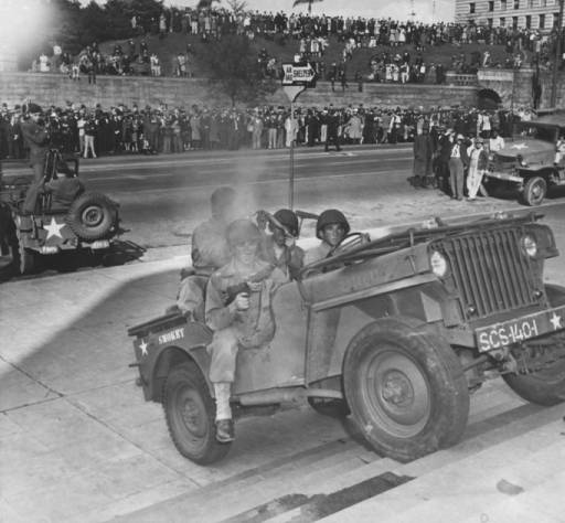 1944-01-04-lapl-archives-jeep-climbs-steps