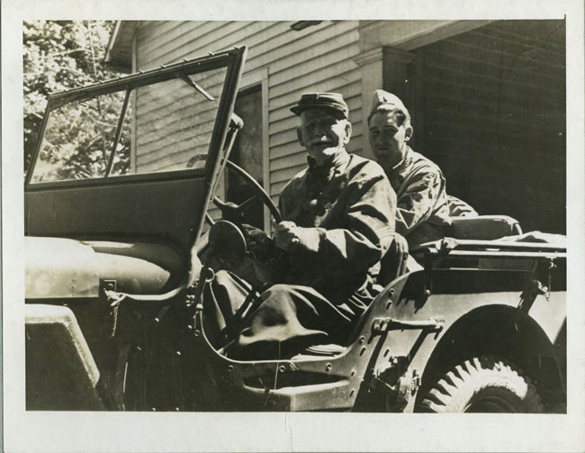 "PHOTO CREDIT: PHOTO CAPTION: Franke E. Ross, age 99 of Murfreesboro, Tennessee, fought in the the infantry away back in Civil War days and now he would like to fight against the Nazis. He said, ""If I could go back a few years, I'd be figting with you fellows."" He proudly steers a Jeep in front of his home during the pause of a unit there while on the maneuvers of the Second Army in middle Tennessee."