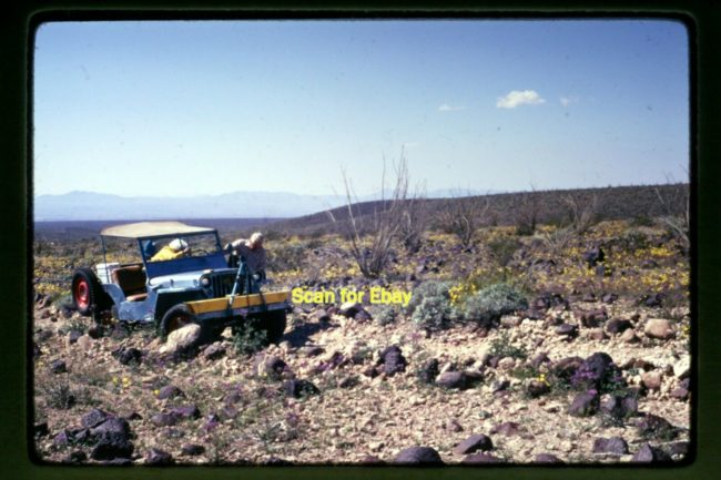 1973-photo-family-pushing-jeep-desert