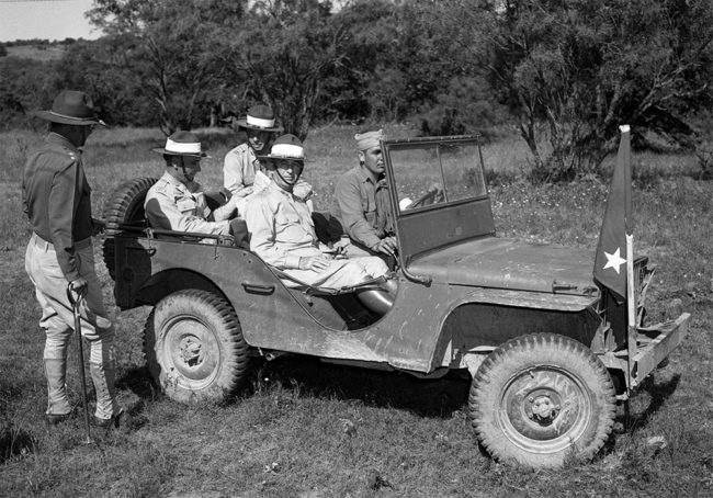 Fort Worth Star-Telegram Collection, University of Texas at Arlington Libraries. Camp Bowie Army maneuvers: Lietenant General Walter Krueger with Major General Claude V. Birkhead and others. (1941). Retrieved from https://library.uta.edu/digitalgallery-beta/img/20053219 ... Camp Bowie Army maneuvers. Four military officers and one military personnel are pictured here. Lieutenant General (LIEUT. GEN.) Walter Krueger, seated in the front passenger seat, Third Army Commander, was in the field almost as much as the participating troops. Here he's leaving 36th Division command post after a conference with Major General (Maj. Gen.) Claude V. Birkhead, division commander, standing by the baby jeep. In the rear seat are, foreground, Lieutenant Colonel (Lieut Col.) George R. Barker, Third Army G-3, and Captain (Capt.) R. H. Chard, Krueger's aid. Driver is Private (Pvt.) Harvey Belote. All are dressed in military uniforms. Published in the Fort Worth Star-Telegram morning edition, June 15, 1941.