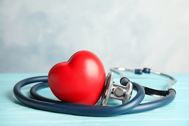 Stethoscope,And,Red,Heart,On,Wooden,Table.,Cardiology,Concept